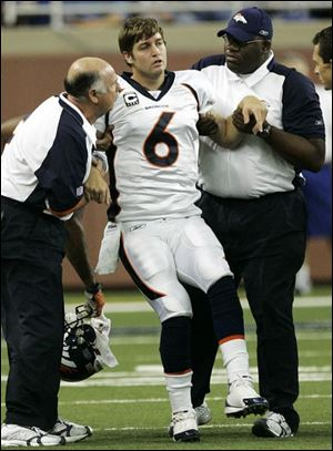 The Broncos' Jay Cutler was injured Sunday when he was sacked by the Lions' Shaun Rogers and Cory Redding. ASSOCIATED PRESS