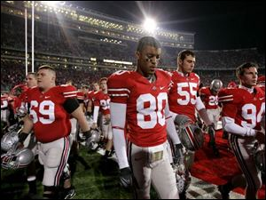 Ohio State wide receiver Brian Robiskie (80) and teammates walk off the field after losing to Illinois  28-21, in a college football game Saturday, Nov. 10, 2007 in Columbus, Ohio.