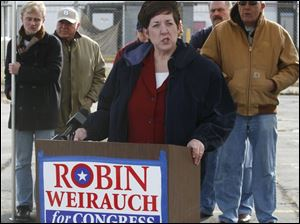 Congressional candidate Robin Weirauch speaks outside the closed TRW plant in Fremont.