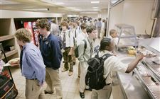 LINING-UP-FOR-FOOD-AT-ST-JOHN-S-JESUIT
