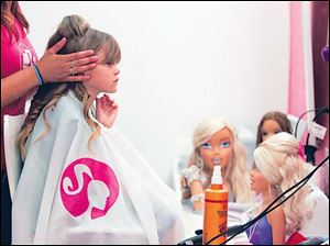 At Casa de Barbie, fans can buy clothes and get their hair styled just like their dolls