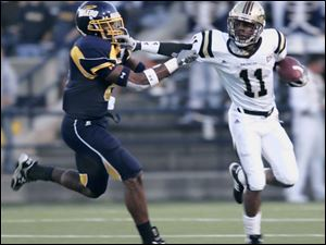 Toledo safety Barry Church, left, shown making a tackle against Western Michigan, is looking for some help on defense next year and is 