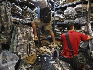 Abercrombie agents identify fake items at a store in Bangkok.