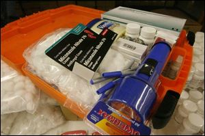 The caregiver kits contain a flashlight, latex gloves, a notebook, and more.