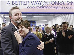 Brush Weirauch hugs his wife, Robin, at her campaign headquarters in Bowling Green after she conceded to Bob Latta Tuesday night.