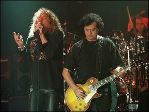 Led Zeppelin's Robert Plant, left, performs with guitarist Jimmy Page during their concert in Istanbul in this March 5, 1998, file photo.
