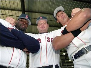 Roger Clemens, center, mugs for the camera with Red Sox 