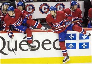 Bryan Smolinski jumps over the boards recently for a shift change with the Canadiens. He joined Montreal this season.