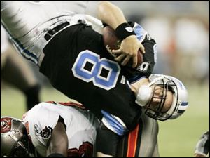 Jon Kitna, getting flipped against the Buccaneers in October, fell short of his goal to win 10 games. The Lions won seven.