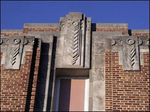 The building is graced with Art Deco adornment. Clay opened in 1926 and was used until the 1950s, when part of the structure became the high school. Clay consisted of 16 classrooms, an auditorium and gym used by the grade school and high school.