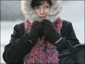 Dorothy Chinnis-Miller of Perrysburg is bundled up for errands in downtown Toledo.