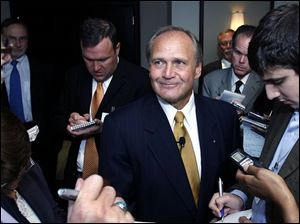 Robert Nardelli was mobbed by reporters at an appearance in Detroit a month after taking over as head of Chrysler LLC.