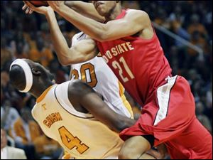 Ohio State's Evan Turner, who led the Buckeyes with 21 points and 10 rebounds, goes into Tennessee's Wayne Chism for a shot.