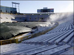 Steam escapes from the giant tarp covering the turf at Lambeau Field, where temperatures are hovering near the zero mark for today's NFC Championship as the Packers host the Giants.