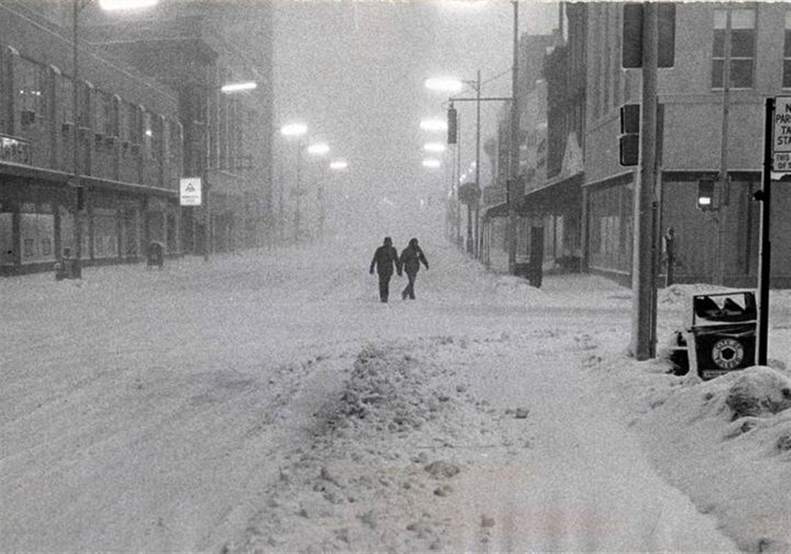 A couple walked downtown on Adams Street as the blizzard raged. (THE BLADE).  2. MORE. Looking back ... 6962a6b69