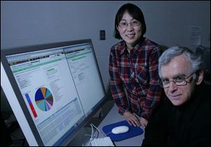 Bowling Green State University biologists Zhaohui Xu, standing, and Paul Morris say computer comparisons will be key for students studying the bacteria in the federal research project.