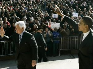 Democratic presidential hopeful, Sen. Barack Obama, D-Ill., right, and Sen. Ted Kennedy, D-Mass., visit an outside overflow crowd on the campus of American University in Washington on Monday.