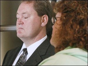 Charles Fackelman, who is with his wife, Janet, is accused of pointing a loaded gun at Randy Krell. Krell was convicted in a 2006 accident that killed Mr. Fackelman's son, 17-year-old Charlie Fackelman. Yesterday the prosecution rested its case in Monroe County Circuit Court. The trial resumes today.