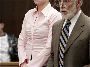 Tiffany Dewey and attorney Alan Konop appear in Toledo Municipal Court. The UT freshman was found guilty yesterday after she pleaded no contest to driving the wrong way on I-475 while she was drunk.