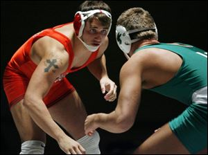 Oak Harbor s Cody Magrum, a two-time Division II state champion, prepares to take on Medina Highland s Ted Bodnar. The189-pound senior, who has a 36-1 record this season with 26 pins, will wrestle at Ohio State.