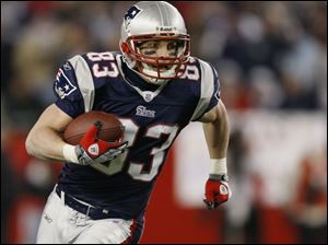 Wes Welker sets a Patriots record for receptions in a season with 112 - good for 1,175 yards and eight touchdowns.