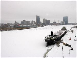 Downtown Toledo was blanketed in white, albeit a rather thin layer compared to what meteorologists had predicted.