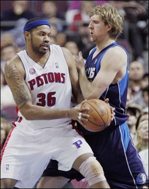 Rasheed Wallace drives against the Mavericks' Dirk Nowitzki. Wallace scored 21 points.