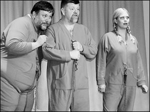 From left, Jeff Smith, Kevin Harrington, and Tara Adams portray three fetuses sharing a womb in Deliver Us Not!