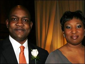 Akinfemi Afolabi and his wife, Tolani, at the Toledo Club for the Bay Park Community Hospital medical staff dinner.