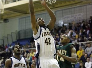 Antwan Willis scores for Whitmer with teammate KevinKoger trailing. Willis averages 13.8 points and 9.1 assists.