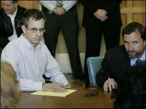 Riems is pictured on left in court.