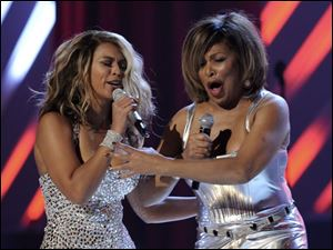Beyonce, left, and Tina Turner perform at the Grammy Awards. (ASSOCIATED PRESS)