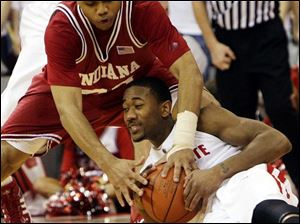 Indiana's Eric Gordon, top, battles for a loose ball with Ohio State's David Lighty. Gordon scored 15 points.