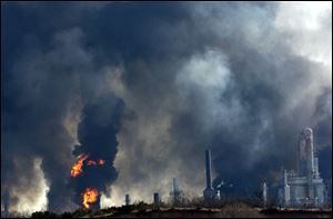 Thick smoke is seen after multiple explosions rocked an oil refinery in Big Spring, Texas, today.