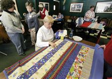 VOLUNTEERS-BLANKET-A-WORKSPACE-WITH-QUILTS-FOR-A-GOOD-CAUSE-2