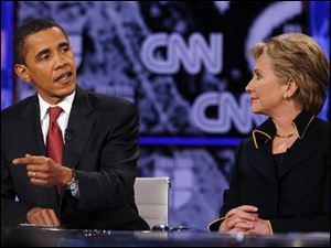 Democratic presidential hopefuls Sen. Barack Obama and Sen. Hillary Rodham Clinton debate at the Recreational Sports Center on the University of Texas campus in Austin, Texas.