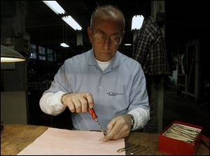 Randy Christy assembles a brand-new but antique pocket knife.