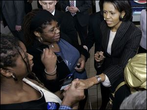 Michelle Obama, wife of Democratic presidential hopeful Barack Obama, shakes hands at Cleveland State University, where she spoke to about 1,000 of her husband's supporters. (ASSOCIATED PRESS)