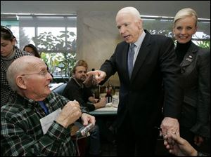 Joe Stockner, 74, of Perrysburg greets Sen. John McCain and his wife, Cindy, during a campaign stop at Charlie's Restaurant in Perrysburg. Yesterday's Perrysburg visit was Mr. McCain's first to the Toledo area during his bid for the GOP nomination. (THE BLADE/DAVE ZAPOTOSKY)
