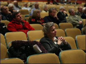 Tiffin resident Jan Dundore listens as panel members discuss the $8.5 million bond issue on the March 4 ballot.