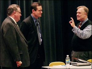 Former Tiffin mayor Bernie Hohman, left, and Seneca County Commissioner Ben Nutter, talk