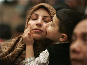 Enas Jaafar and her son, Mustapha Chouaib, 4, mark the occasion.
