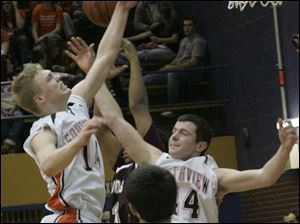 Southview's Andy Borcherdt, left, and Jordan Scott battle Scott's David Sweeney, back, for an offensive rebound last night.