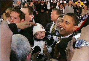 Sen. Barack Obama (D-Il) at the University of Toledo on Sunday stops to see a baby he noticed during his address to about 9,000 people at Savage Hall. Obama made his away around the crowd following his campaign stop.