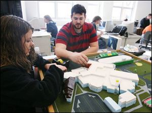 Above, Clay High School computer-aided drafting and design students Elizabeth Schenk, left, and Mychael Wagoner work on an architectual model of the school.