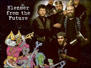 The Klingon Klez band, billed as Klezmer from the Future, is scheduled to perform February 29, 2008, at Owens Community College. From left, Tom Cohen, Stan Slotter, Jack Kessler, Dave Posmontier, Bob Butryn, and, bottom, Joe Kessler.