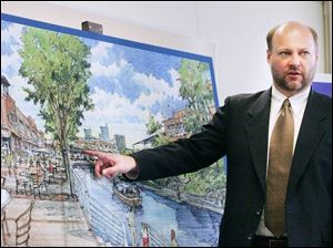 Jeffrey Fleischman of Tetra Tech indicates areas of interest on an artist's rendering of the proposed condominium-townhouse project on property near the Farmers Market in downtown Toledo. Mayor Carty Finkbeiner said the project is dynamic, but realization is a long way off.