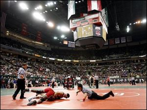 Oak Harbor's Cody Magrum records a pin of Demond Sanford of Finneytown in their 189-pound match in the Division II state wrestling tournament that began yesterday at the Schottenstein Center on the campus of Ohio State. (THE BLADE/ANDY MORRISON)