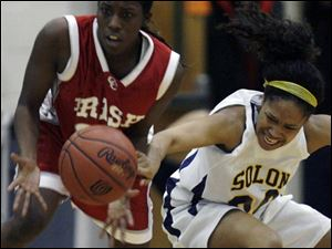 Central Catholic s Sharise Calhoun steals the ball from Solon s Skylar Cumberlander.