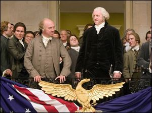 Paul Giamatti, center left, and David Morse in the new HBO series <i>John Adams</i>, debuting Sunday night.